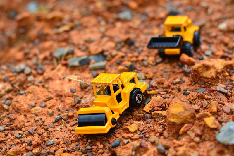 Excavator Toy work at construction site stock image