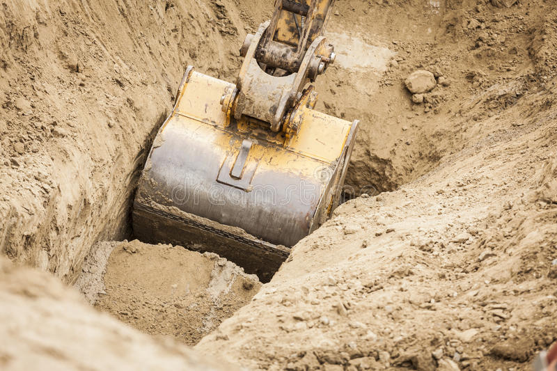 Excavator Tractor Digging A Trench. Working Excavator Tractor Digging A Trench royalty free stock images