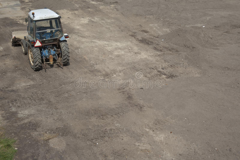 Excavator tractor levelling land. For further construction royalty free stock photography