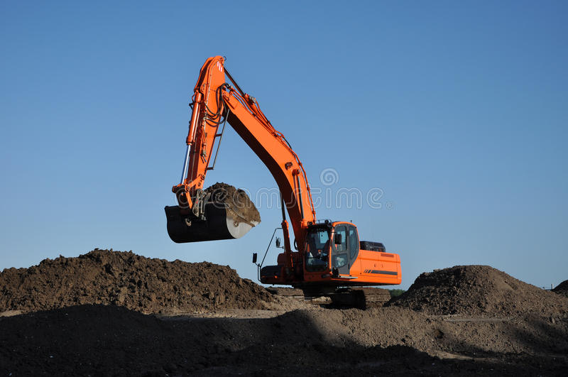Excavator at work stock photos