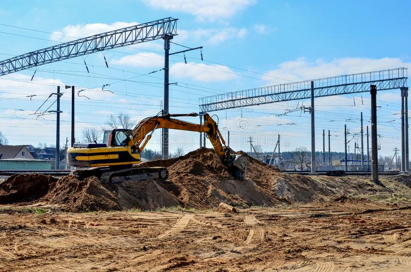 Excavator working on a construction site on railway. Excavator working on a construction site on the railway royalty free stock images