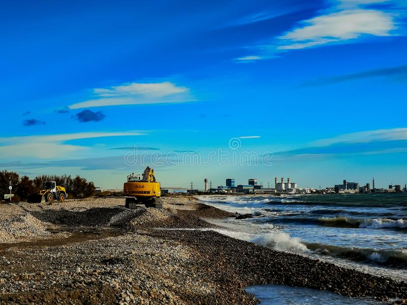 Excavator working on a beach royalty free stock images