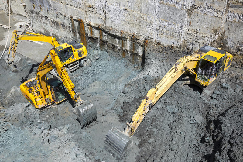 Excavators Baggers digging at a construction site stock image
