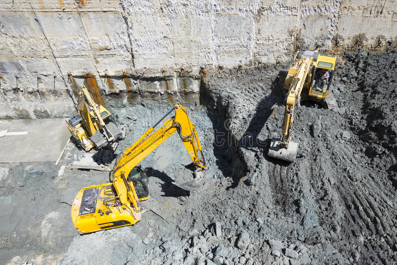 Excavators Baggers digging at a construction site stock photography