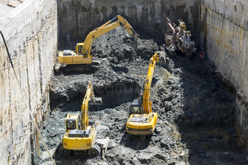 Excavators Baggers digging at a construction site stock photos