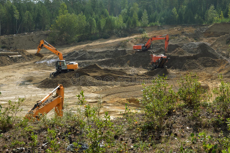Excavators are developing a sand pit. stock photo