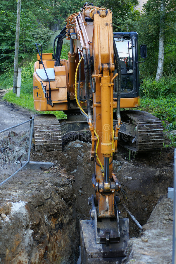 Excavatrice de construction de routes photo libre de droits