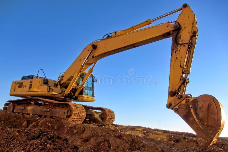 Excavatrice hydraulique au chantier de construction images stock