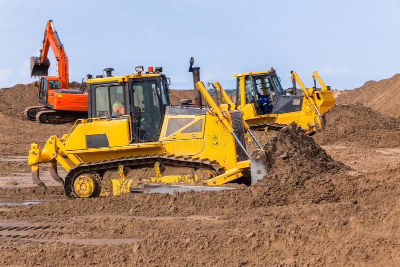 Excavatrice Machines de bouteur de construction de terrassements photographie stock libre de droits