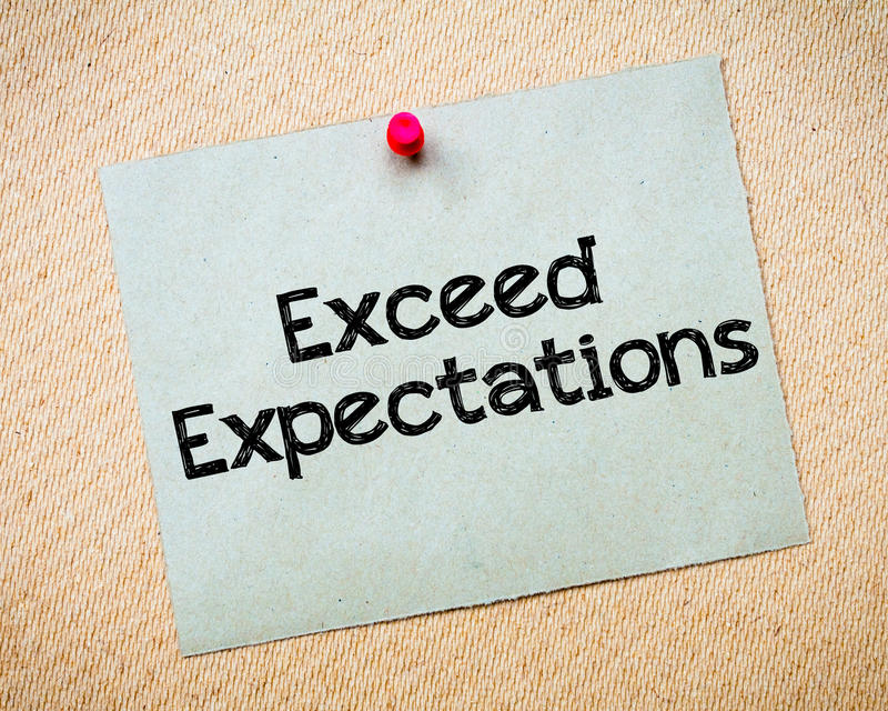 Exceed Expectations. Message. Recycled paper note pinned on cork board. Concept Image stock image