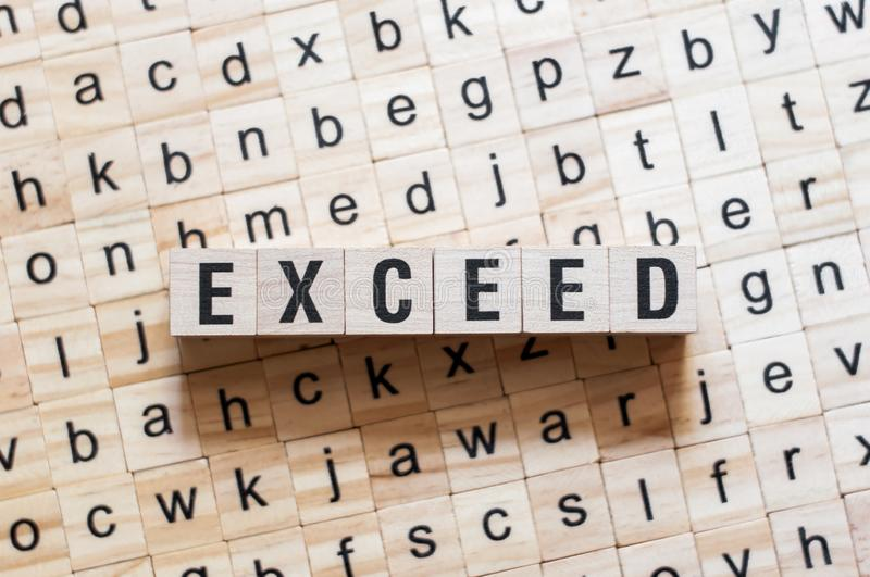 Exceed word concept. On cubes stock photo