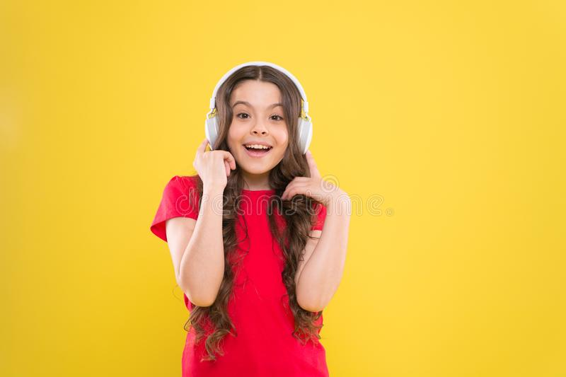 Excellent audio sound quality. Child teen enjoy music playing in earphones. Little girl enjoying favorite music. Catch royalty free stock photography