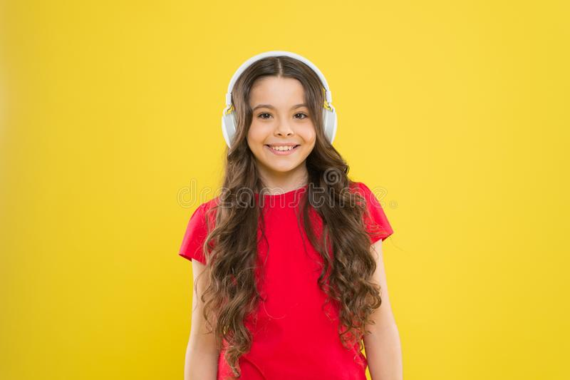 Excellent audio sound quality. Top songs. Child teen enjoy music playing in earphones. Little girl enjoying favorite stock photography