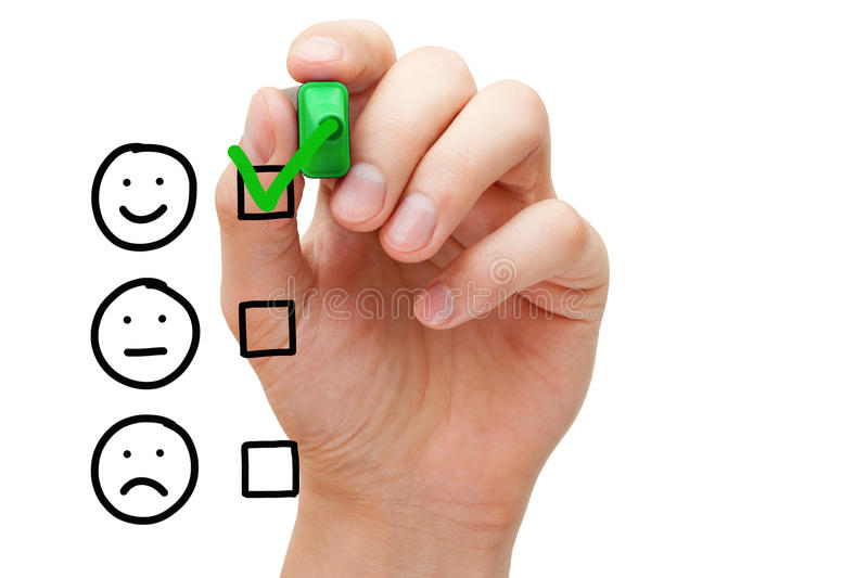 Excellent Customer Service Evaluation Form. Hand putting check mark with green marker on excellent customer service evaluation form stock image