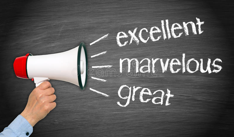 Excellent feedback. Hand with a megaphone and the words excellent, marvelous and great written on a blackboard, business feedback concept royalty free stock photo