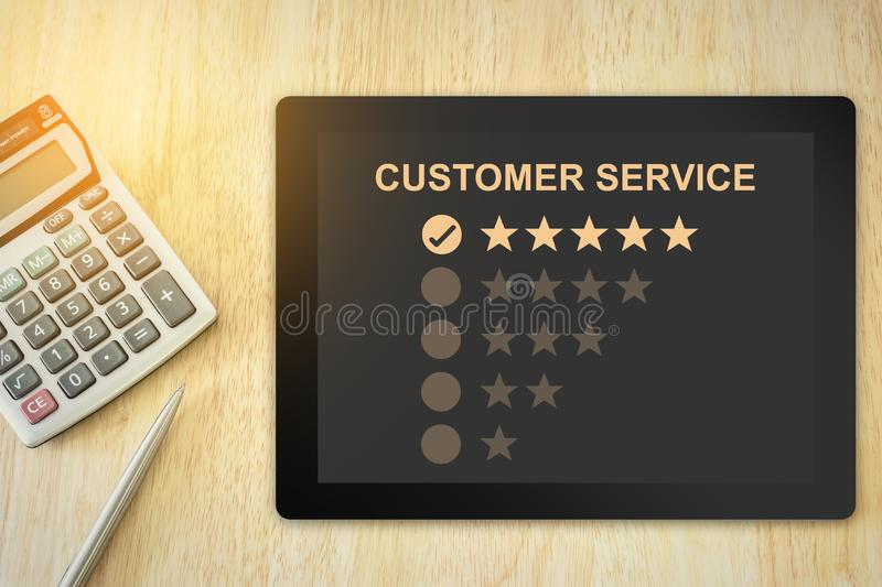 Excellent five stars customer service on tablet. With soft light vintage effect stock images