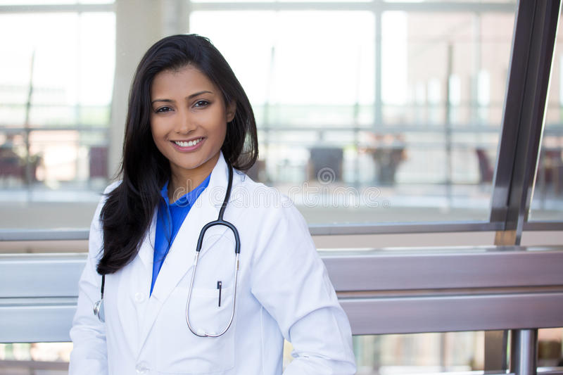 Excellent healthcare professionals. Closeup headshot portrait of friendly, cheerful, smiling confident female, healthcare professional with lab coat. isolated royalty free stock images
