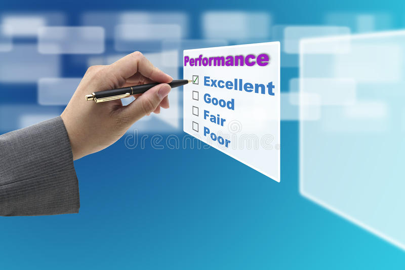 Excellent Performance Audit. Business Man Hand Check on Excellent Choice on Annual Performance Evaluation audit royalty free stock photography