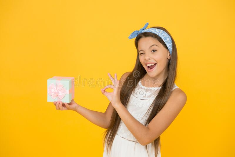 Excellent quality. Buy gift. Online shopping. Perfect gift concept. Celebrate holidays. Cute small kid adorable dress. Girl long hair hold gift box. Present royalty free stock photos