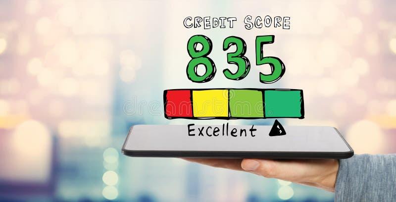 Excellent thème de score de crédit avec la tablette photographie stock