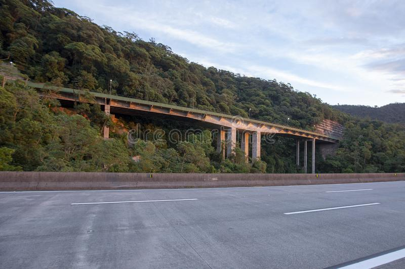 Excerpt of the Immigrant Highway, with no cars. With views of the way up and down the hill. Sao Paulo, SP, Brazil stock photo