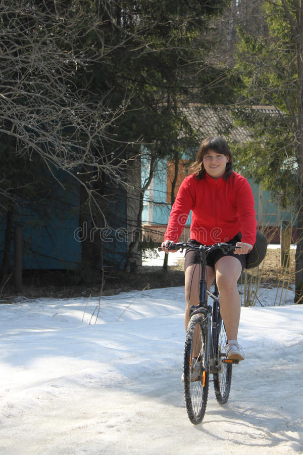 Excess Weight Girl On The Bicycle Stock Images