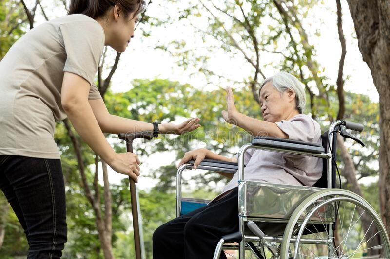 Excessive afraid in senior woman patients rejecting,gesture hand NO,female elderly who refuses to walk,asian old people fear of stock photo