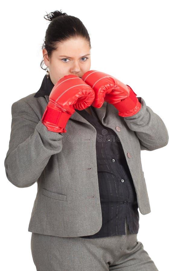 Excesso de peso, mulher de negócios gorda em luvas de encaixotamento foto de stock