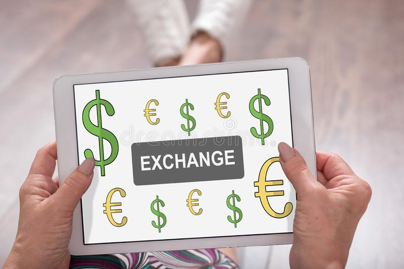 Exchange concept on a tablet. Exchange concept shown on a tablet held by a woman royalty free stock photography