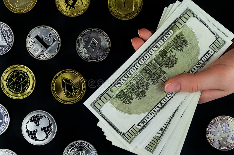 Exchange cryptocurrency for real money at the current rate. Exchange cryptocurrency for real money at the current market rate royalty free stock photos