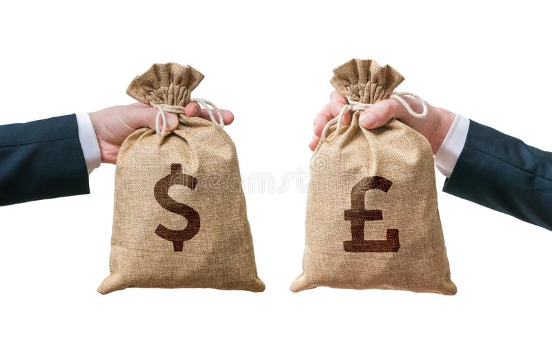 Exchange currency concept. Hands hold bag full of money - Dollar and British pounds stock photos