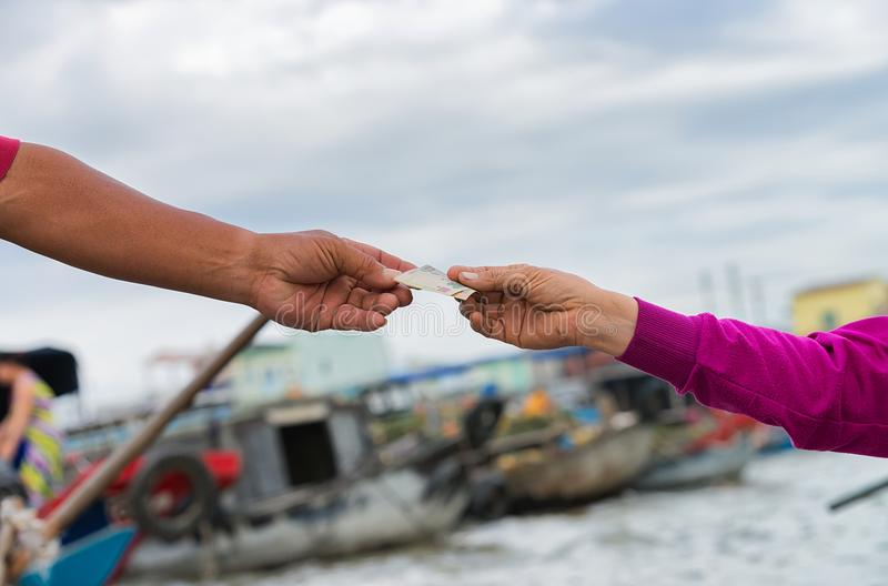 Exchange of money at Floating market Can Tho Vietnam stock image