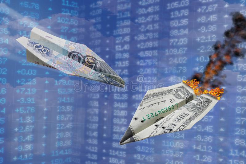 Exchange rate illustration. Strong ruble rate hits dollar like one war paper plane hits another. Ruble vs dollar. Russian currency stock image