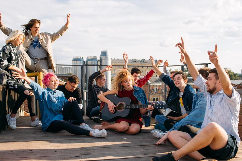 Exchange students singing rooftop together bonding royalty free stock image