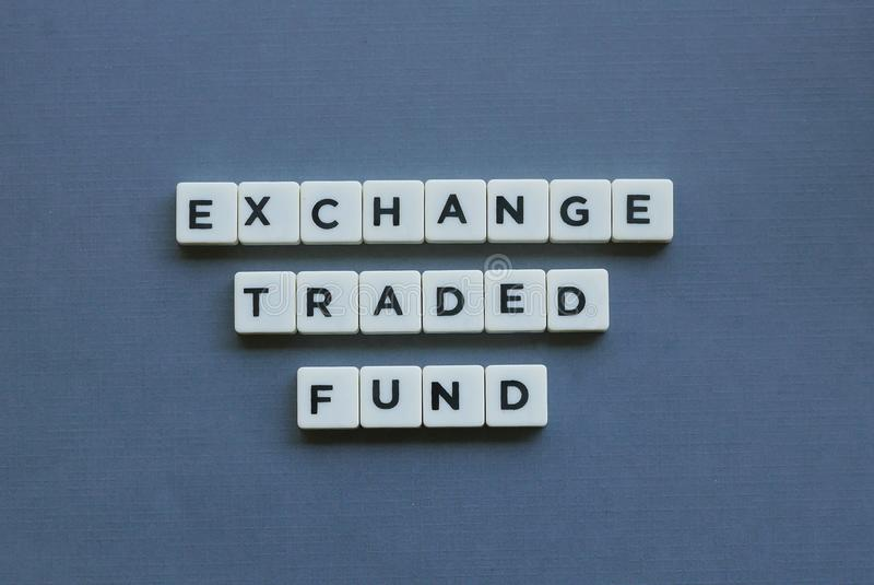 & x27; Exchange Traded Fund & x27; word made of square letter word on grey background. Etf, concept, investment, business, financial, profit, growth, stock royalty free stock image