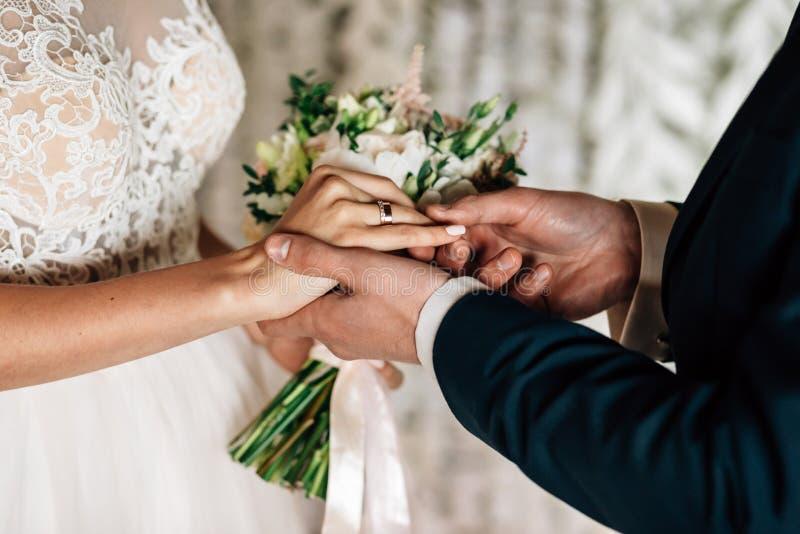 Exchange of wedding rings. White stock photos