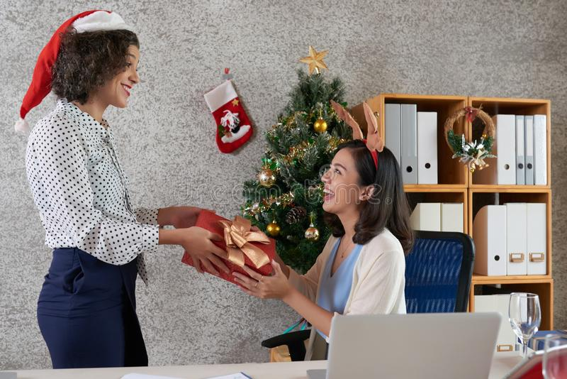 Exchanging Christmas presents stock image