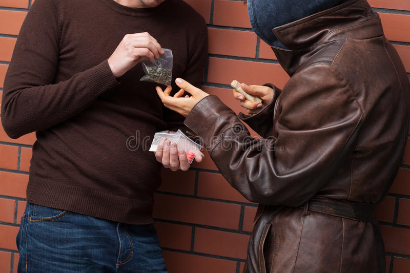 Exchanging drugs for money royalty free stock photography