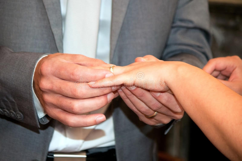 Exchanging the rings royalty free stock photo