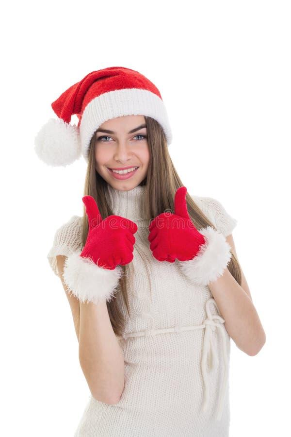 Excited девочка-подросток при шляпа Санты показывая большие пальцы руки вверх стоковые фотографии rf