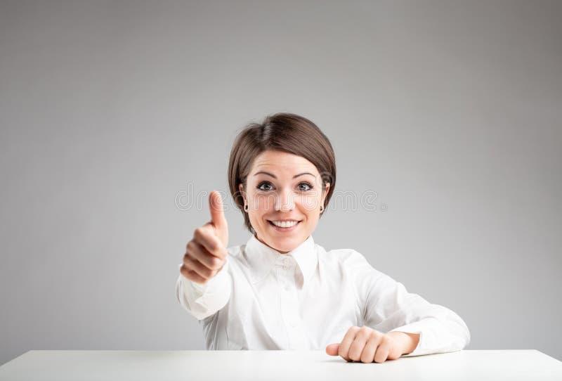 Excited женщина делая большие пальцы руки вверх показывать стоковое фото rf