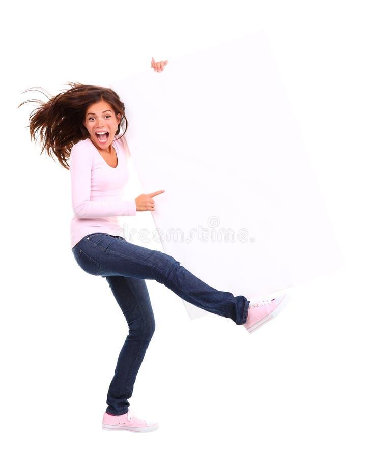excited женщина знака удерживания стоковое изображение
