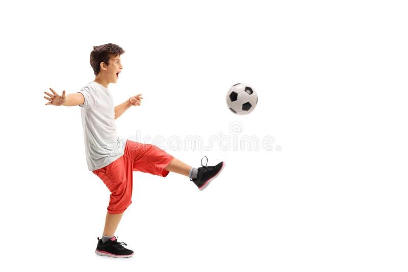 Excited мальчик играя футбол стоковое фото rf