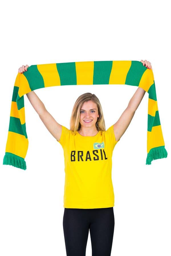 Excited футбольный болельщик в футболке Бразилии стоковое фото rf
