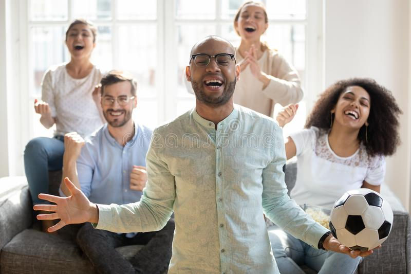 Excited African American man with diverse friends celebrating football win royalty free stock photos