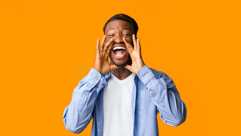 Excited Afro Guy Shouting Standing Over Orange Studio Background, Panorama stock photos