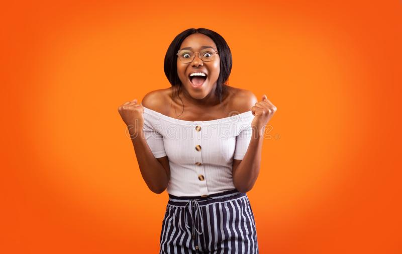 Excited Afro Lady Shouting Shaking Fists Celebrating Success, Studio Shot royalty free stock photography