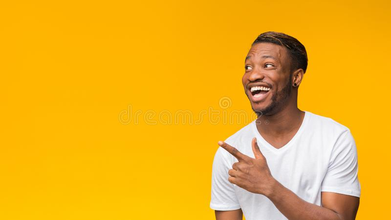 Excited Afro Man Pointing Finger Aside, Studio Shot, Panorama royalty free stock image