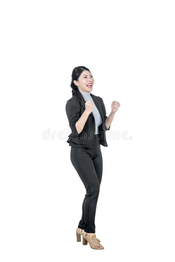 Excited asian business woman raise hands celebrates success royalty free stock photography