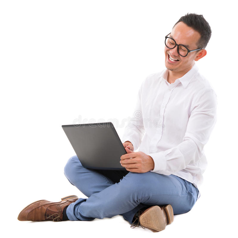 Download Excited Asian Male Using Laptop Stock Image - Image: 32465125